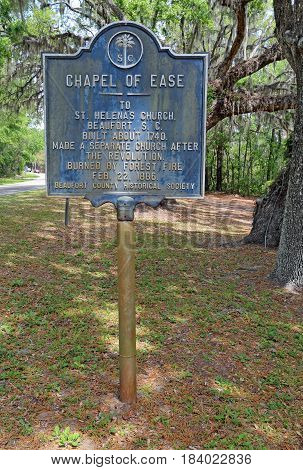 SAINT HELENA ISLAND SOUTH CAROLINA - APRIL 16 2017: Historical information sign for the Saint Helena Chapel of Ease on Saint Helena Island in Beaufort County South Carolina