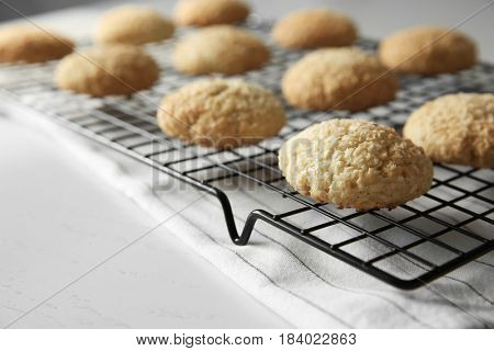 Delicious coconut cookies on baking rack, closeup