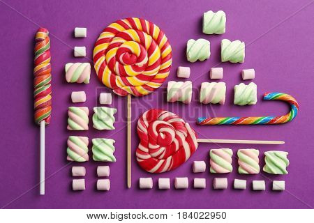 Composition with tasty sweets on color background