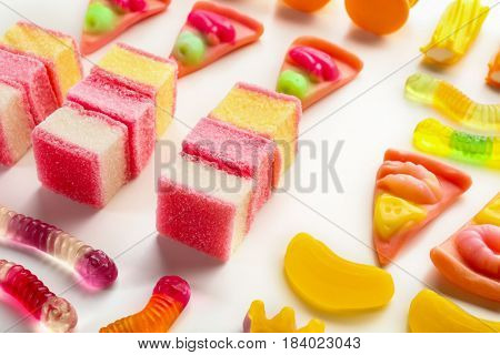 Composition of colorful jelly candies on white background, closeup