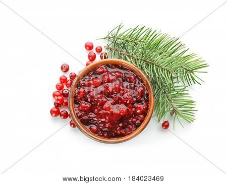 Delicious cranberry sauce in bowl on white background, top view