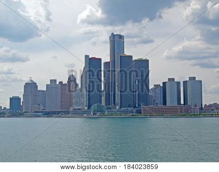 DETROIT - JUlLY 7, 2016, From the Detroit River the skyline of downtown Detroit, Michigan is seen under a cloudy sky.