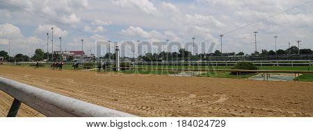 horses racing down the stretch at Churchill Downs, May 27th, 2016