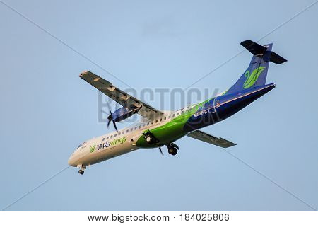 Labuan,Malaysia-Nov 24,2014:MASwings Airlines ATR-72-500 takes off from Labuan Airport on Nov 24 2014.MASwings is the regional community airline for East Malaysia states of Sabah and Sarawak, also fondly known as Borneo.