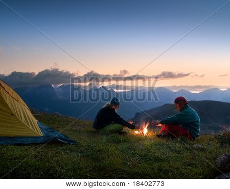 couple camping in the wilderness