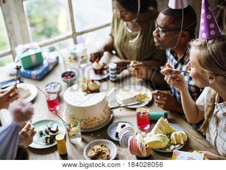 People Eating Cake on Birthday Party Celebration