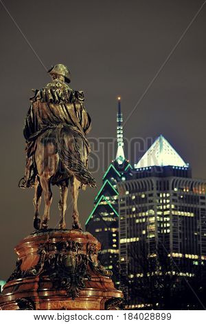 George Washington statue and Philadelphia city architecture at night