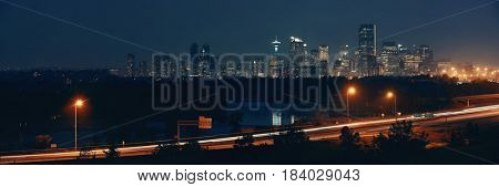 Calgary cityscape and highway in Alberta at night, Canada.