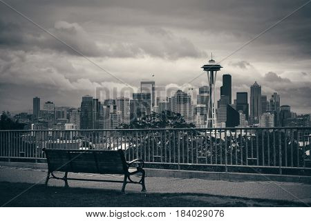 Seattle city view from Kerry Park with urban architecture and bench.