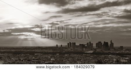 Paris city skyline rooftop view with la Defense at sunset, France.