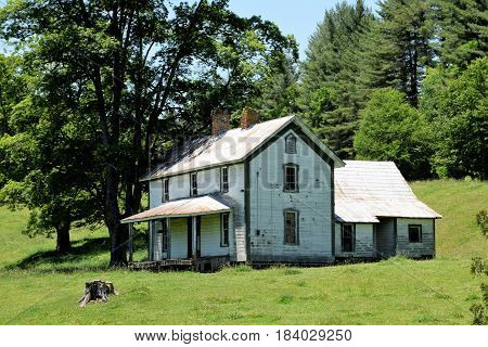 Old Farm House in the mountains nestled in a Valley.