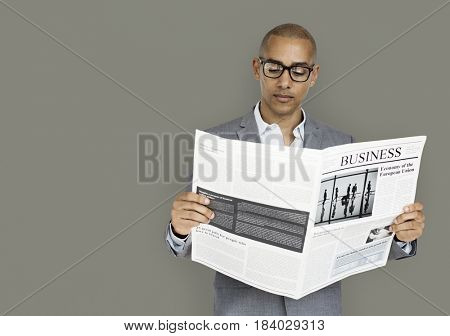 African Descent Business Man Reading Newspaper