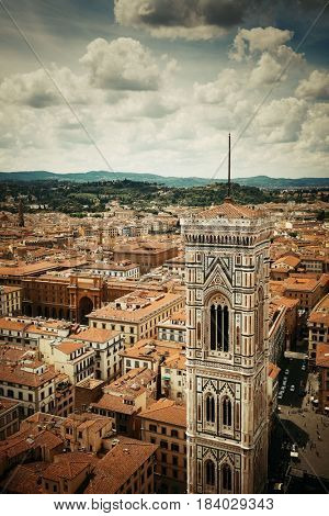 Duomo Santa Maria Del Fiore bell tower and city skyline in Florence Italy.