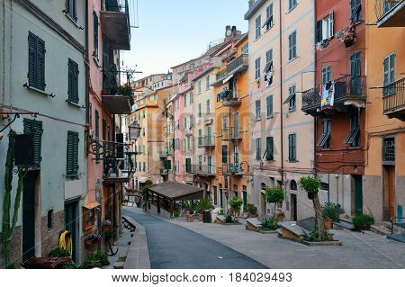 Main street with restaurants and shops in Riomaggiore in Cinque Terre, Italy.