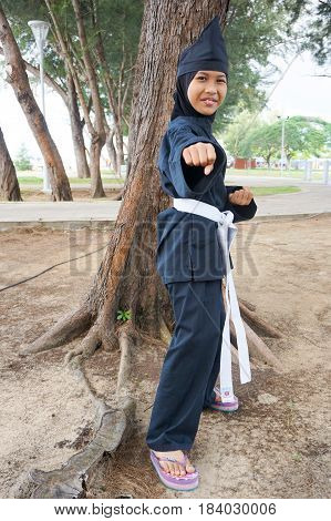 Labuan,Malaysia-Apr 29,2017:Brunei kid of Labuan in traditional martial art silat costume during performed at Malay Wedding Ceremony at Labuan,Malaysia on 29th April 2017.