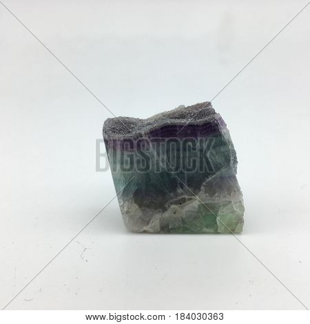 A purple and green natural fluorite not in geometric formation