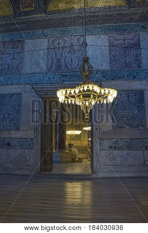 ISTANBUL, TURKEY - SEPTEMBER 29: Hagia Sophia indoor shot with chandelier in a passge on September 29, 2011 in Istanbul. It is a former Orthodox patriarchal basilica, later a mosque, and now a museum.