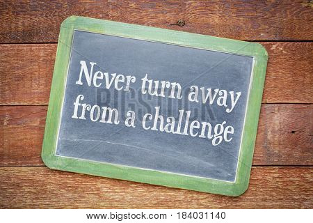 Never turn away from a challenge blackboard sign against rustic barn wood table