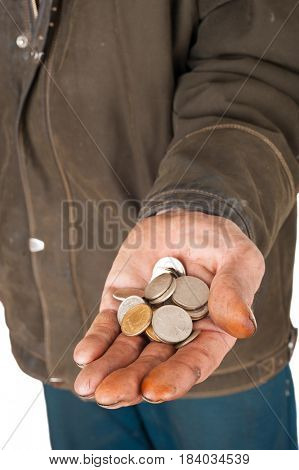 Hand of a beggar with coins