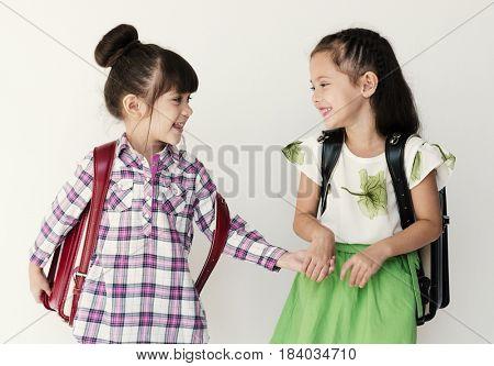 Girls Friends Studio Shoot Holding Hands Going to School White Background