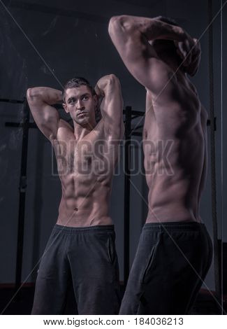 Bodybuilder Posing, Looking At Himself, Double Mirror Image