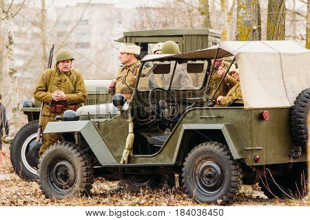 Gomel, Belarus - November 26, 2016: Soldiers of the Red Army of the USSR stand near a military machine. Reconstruction of the battle - liberation of Gomel