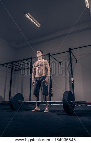 Bodybuilder Standing Posing, Weights Bar Barbell, Dark Gym Indoors