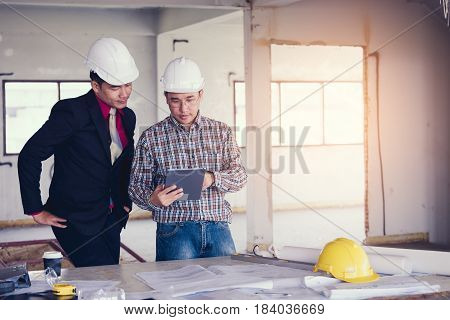 Management Consulting And Engineers Working With Tablet And Drawing On Work Table In For Management