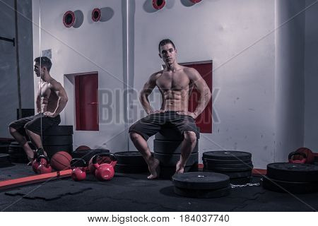 One Young Adult Man, Bodybuilder, Looking Posing Fitness Equipment Sitting