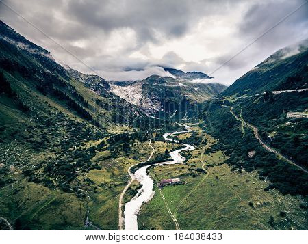 Mountain landscape in the Swiss Alps, as seen from the small village of Gletsch and looking towards the Rhone Glacier Furka Pass. This shot was taken from a UAV and not from ground level.