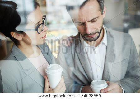 Businesswoman reassuring her colleague during coffee-break