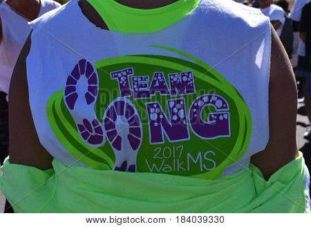 LANCASTER, CALIFORNIA - APRIL 29, 2017: A participate just before the start of the 2017 walk for multiple sclerosis (MS) wearing one of the gold sponsors (Northrop Grumman) team T-Shirt