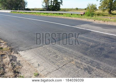 Asphalt pavement. Road Pavers New Asphalt Laid Down. Asphalt paving - New road construction