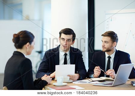 Two confident employers hiring new candidate for work