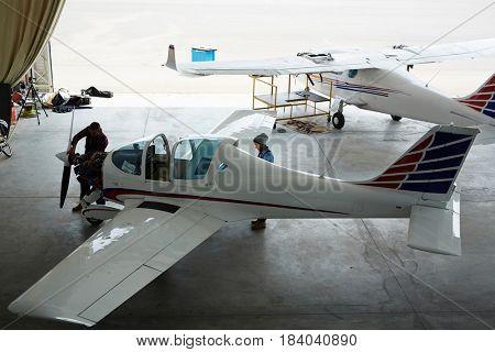 Wide angle shot of jet planes repair in maintenance hangar