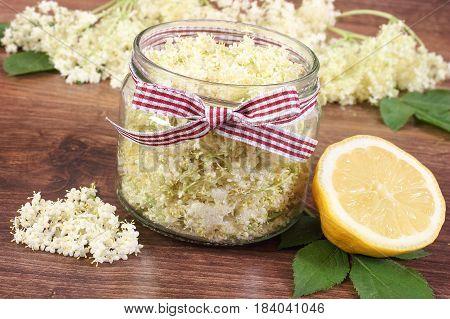 Elderberry Flowers And Lemon For Preparing Fresh Healthy Juice On Rustic Board