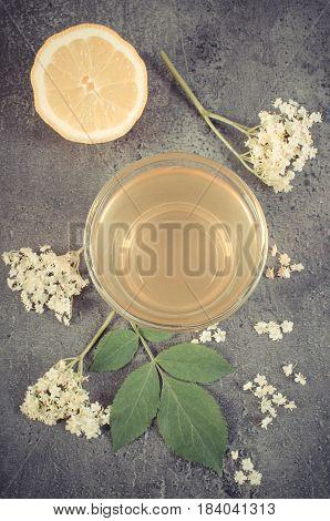 Vintage Photo, Fresh Healthy Juice, Elderberry Flowers And Lemon On Structure Of Concrete