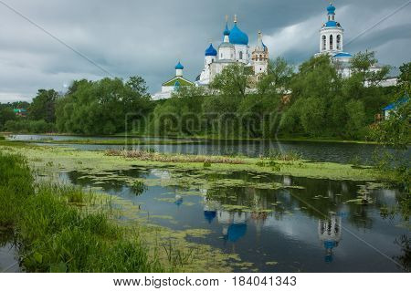 Image of white church with blue domes and scenic clouds, Bogolubovo, Russia
