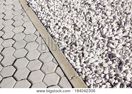 Floor design with terrace tiles and ornamental gravel Various materials for flooring in the garden Building materials for gardening Professional gardening .