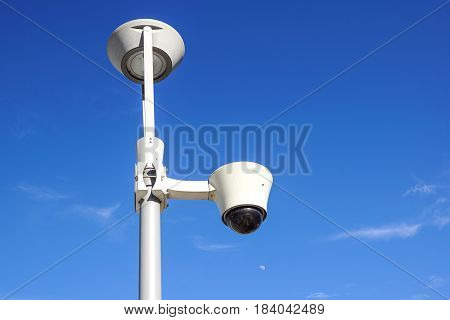 security cctv cameras on a pole with blue sky background .