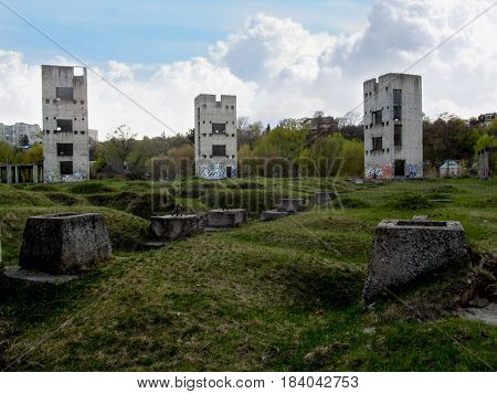 Three dilapidated sullen towers. Abandoned construction of three old tall buildings in the middle of the wasteland
