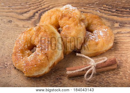 Sugary Donut On A Wooden Background