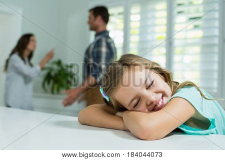 Smiling girl resting in living room at home