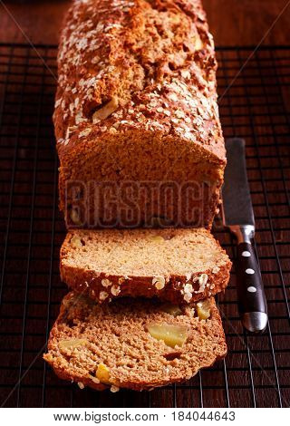 Stout and apple wheaten bread sliced on wire rack