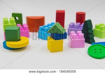 Children's toys are made of colorful wood on a white background.