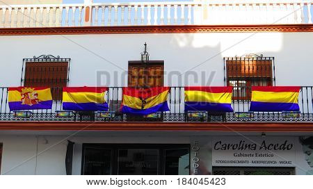 Alora Spain - April 14 2017: Balcony displaying five Republican Spanish flags on the official day of the Second Spanish Republic