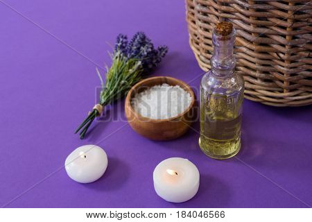 Set of spa accessories arranged on purple background