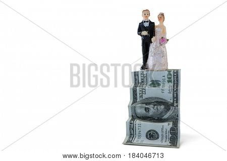 Wedding couple figurines on US dollar banknote against white background