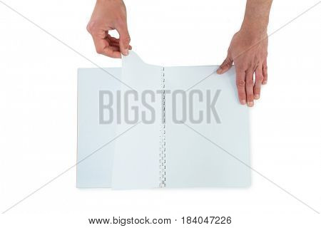 Hands turning pages of blank book on white background