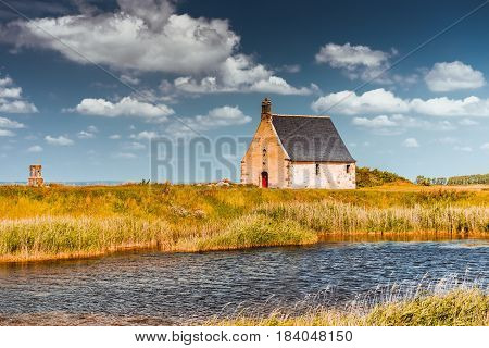 summer landscape of Bretagne with old church, , Brittany, France